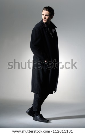 side view of a walking business man, looking to the camera, - stock photo