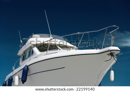 Side view of a yacht under deep blue sky - stock photo