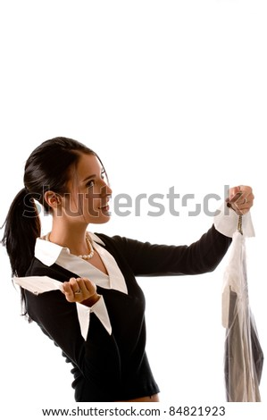 Side view of a young beautiful brunette woman with her dry cleaning in one hand and a receipt in the other. She looks concerned about her receipt. - stock photo