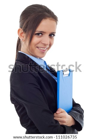 Side view of a young business woman holding a clipboard and smiling .Facing the camera. Isolated on white background - stock photo