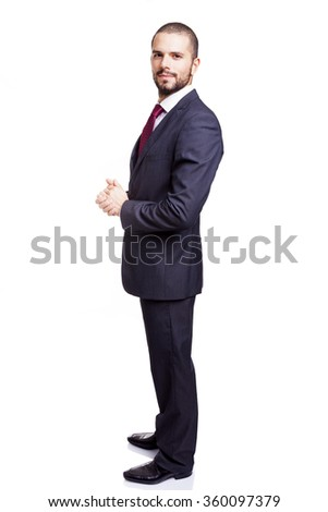 Side view of a young businessman, isolated on white background