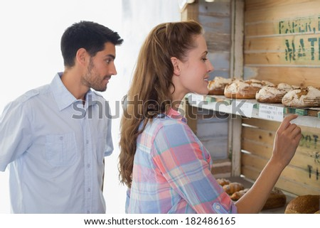 Side view of a young couple at the bakery store
