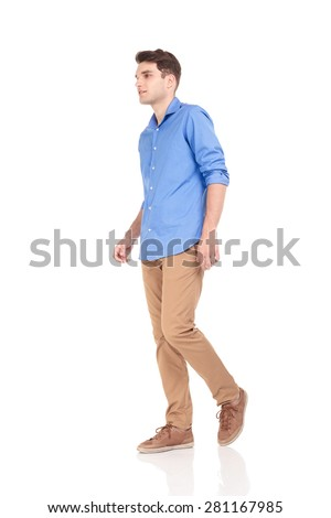 Side view of a young fashion man walking on isolated background. - stock photo