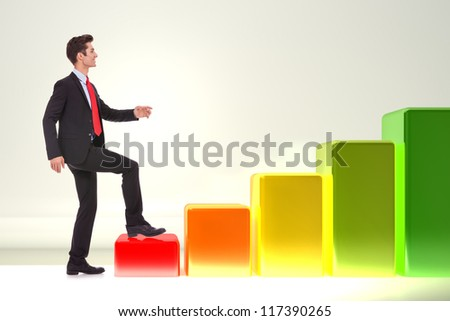 side view of a young smiling business man stepping forward on a growing graph - stock photo