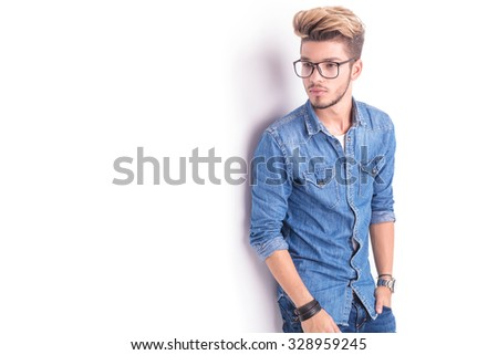 side view of a young student with glasses looking away from the camera on white background - stock photo