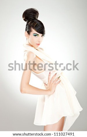 Side view of a young woman model leaning back with her hand on the waist - stock photo