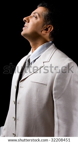 side view of adult executive looking up - stock photo