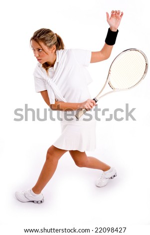 side view of adult tennis player playing tennis on an isolated white background - stock photo