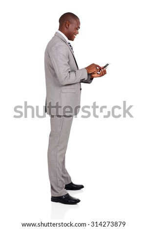 side view of afro american businessman using smart phone - stock photo