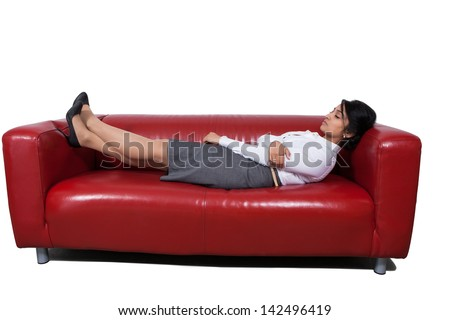 Side view of an Asian businesswoman sleeping on sofa