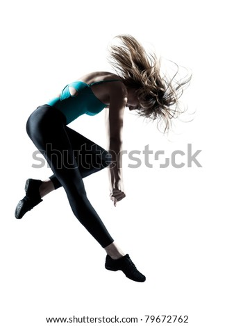 Side view of an energetic female doing aerobics isolated on white background - stock photo