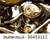 Side view of an engine of motorcycle in sepia. - stock photo