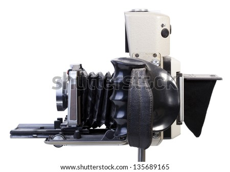Side view of an old fashioned dusty vintage camera isolated on white background. Clipping path included.