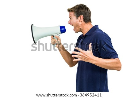 Side view of angry man shouting through megaphone against white background - stock photo