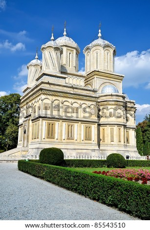 Side view of Arges Monastery in Curtea de Arges, Romania. - stock photo