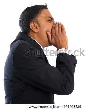 Side view of Asian Indian businessman shouting over white background - stock photo