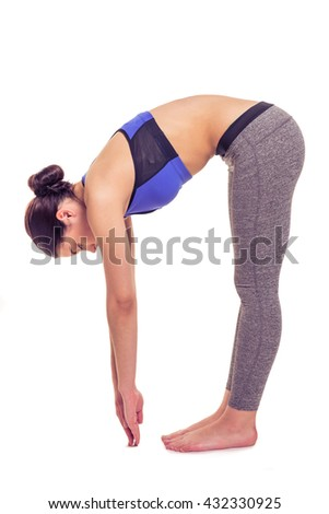 Side view of attractive young woman in sportswear stretching while doing yoga,  isolated on white background - stock photo