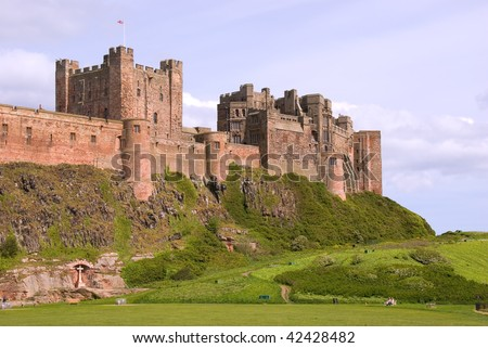 Side view of Bamburgh Castle - stock photo