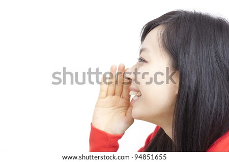 Side view of beautiful young woman whispering message isolated on white background - stock photo