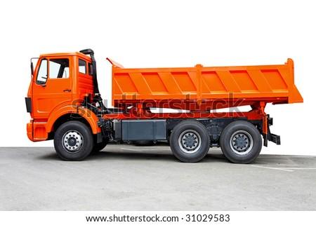 Side view of big orange truck tipper - stock photo
