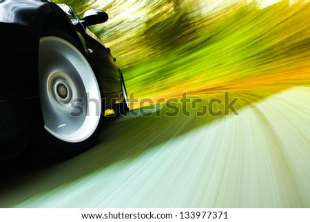 Side view of black car in turn. - stock photo