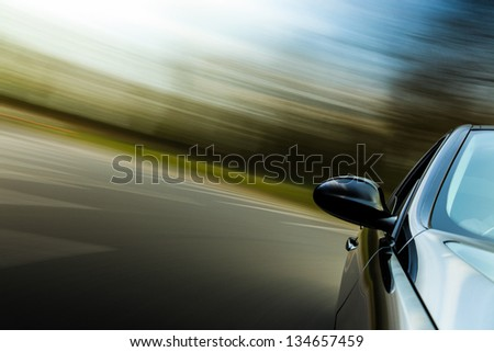 Side view of black sport car in turn. - stock photo