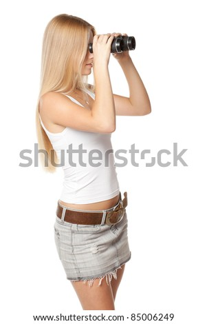 Side view of blond woman looking through binoculars over white background - stock photo