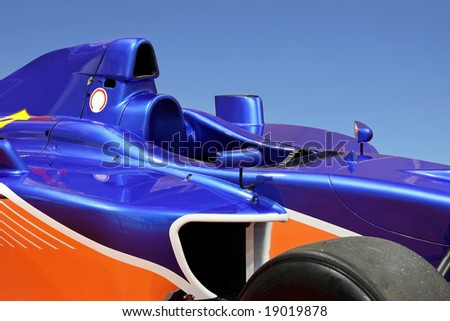 Side view of blue formula one racing car - stock photo