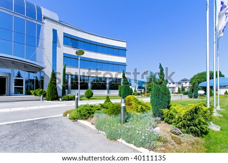 Side view of blue glass office building - stock photo