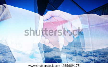 Side view of business peoples hands shaking against skyscraper - stock photo