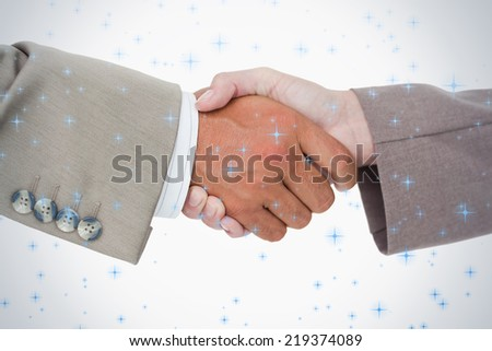 Side view of business peoples hands shaking against twinkling stars - stock photo