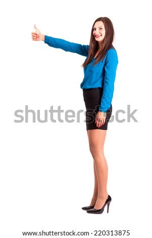 Side view of business woman with thumbs up gesture looking at camera. Full body length isolated over white background. - stock photo