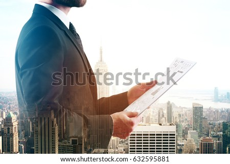 Side view of businessman holding document on city background. Double exposure