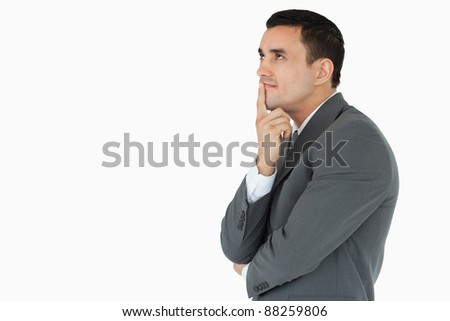 Side view of businessman in thoughts against a white background