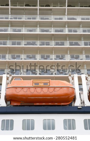 Side view of cabins on cruise liner with lifeboat. No people and ship are unrecognizable. - stock photo