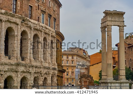 Side view of colloseum with second ruin - stock photo