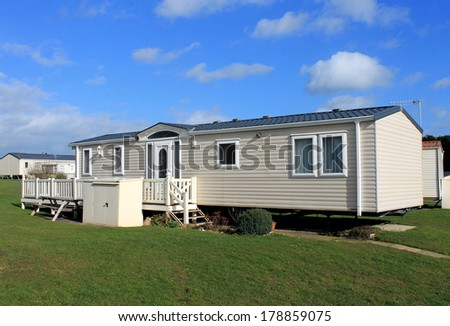 Side view of cream colored caravans in modern trailer park, England. - stock photo