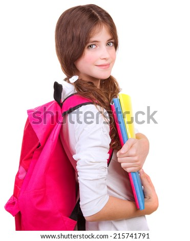 Side view of cute brunette schoolgirl with big pink schoolbag and holding in hands colorful textbooks, isolated on white background, back to school concept  - stock photo