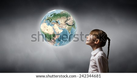 Side view of cute girl and Earth planet above her head. Elements of this image are furnished by NASA - stock photo