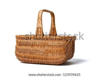 Side view of empty wicker basket isolated on white background - stock photo