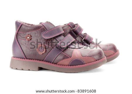 Side view of fall shoes for little girl over white background, shallow deep of field