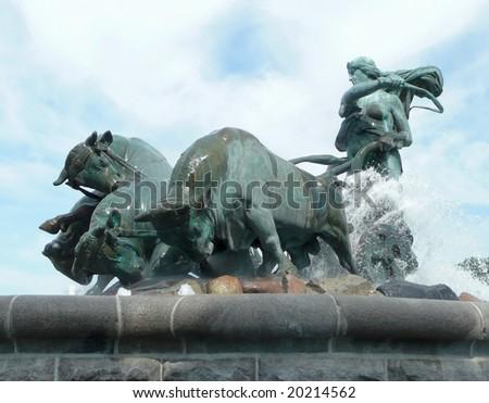 side view of famous bronze Gefion Fountain in Copenhagen Denmark by Anders Bundgard - stock photo