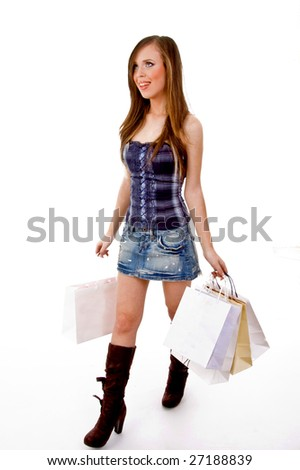 side view of female carrying bags and looking up with white background - stock photo