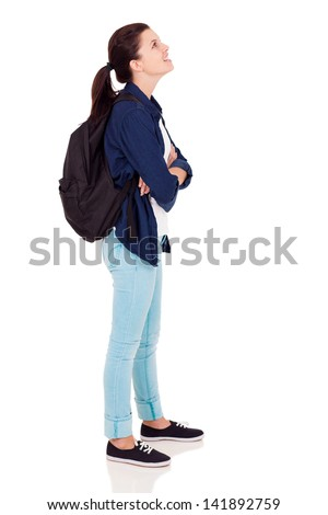 side view of female high school student looking up on white background - stock photo