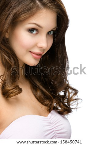 Side view of girl with hair ringlets, isolated on white. Concept of beauty and youth