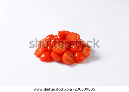 side view of halved cherry tomatoes heap - stock photo