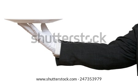 side view of hand in white glove with empty flat white plate isolated on white background - stock photo