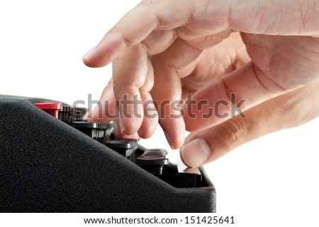 Side view of hands on a typewriter keyboard with a white background - stock photo