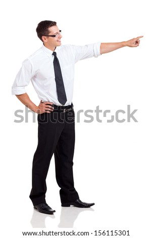side view of happy businessman pointing on white background