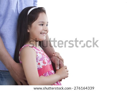 Side view of happy girl holding father's hand against white background - stock photo